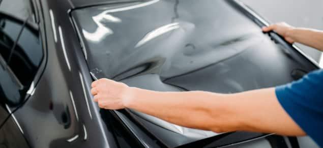 car tech at cozy car installs window tinting professionally